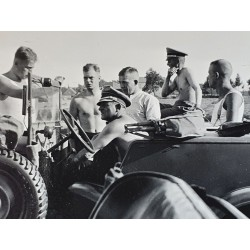 original photography SS General Sepp Dietrich with a bare torso, sitting in an open car